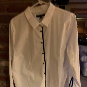 White blouse w/black buttons & black trim.